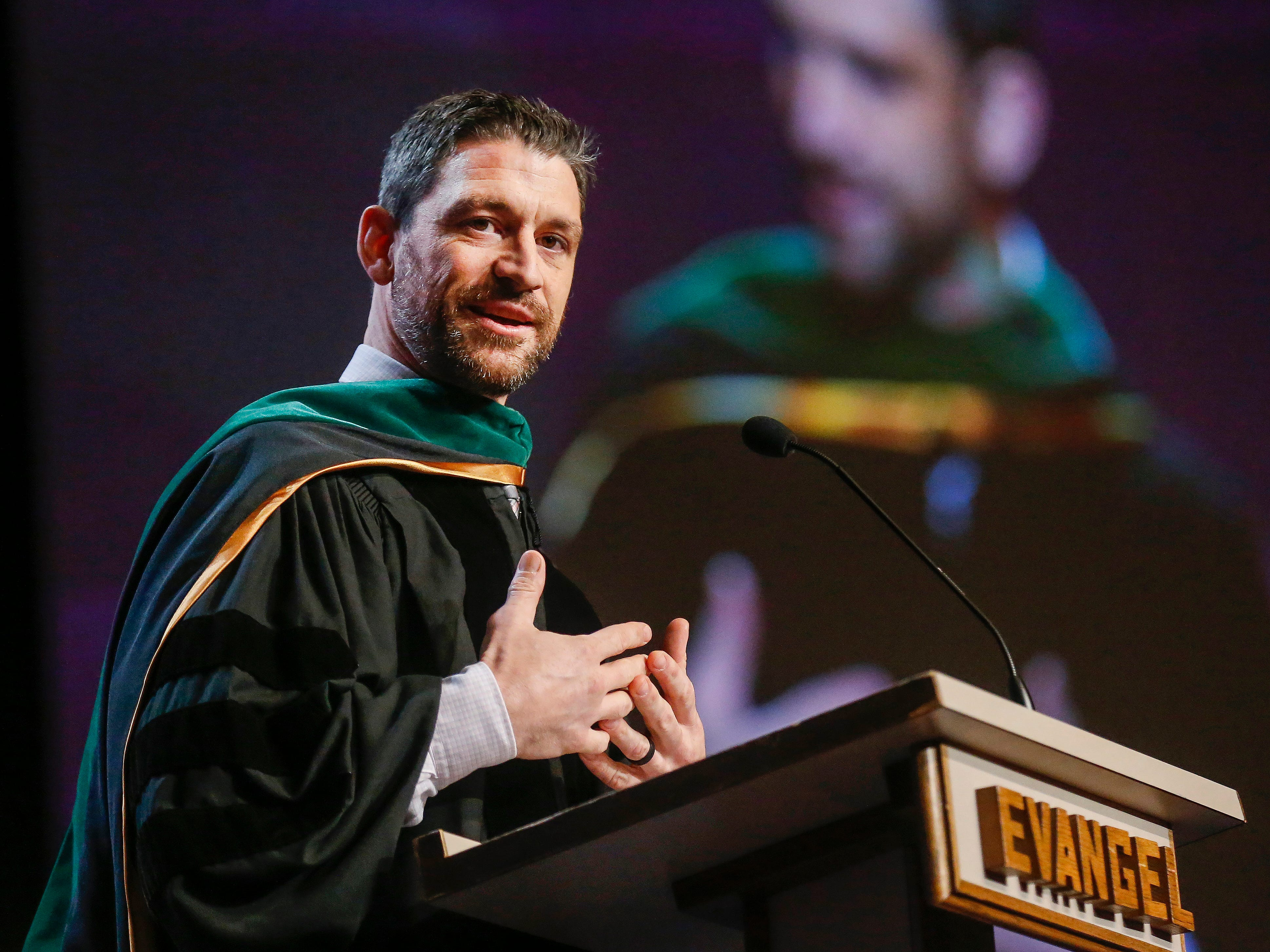 Dr. Gregory Mundis delivers the commencement address during Evangel University's 2019 Commencement Ceremony at James River Church in Ozark on Friday, May 3, 2019.