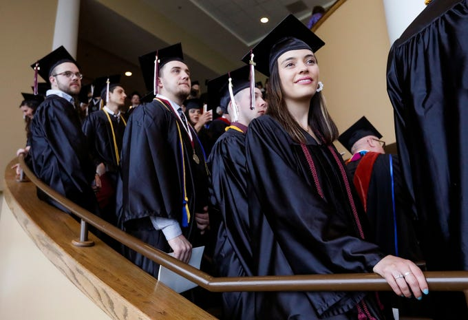 Skyler McAlister, right, lines up with the rest of her class before Evangel University's 2019 Commencement Ceremony at James River Church in Ozark on Friday, May 3, 2019.