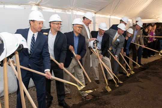 Members of the CoxHealth Board of Directors put their shovels to work at Wednesday's groundbreaking ceremony for the new Cox Monett Hospital.