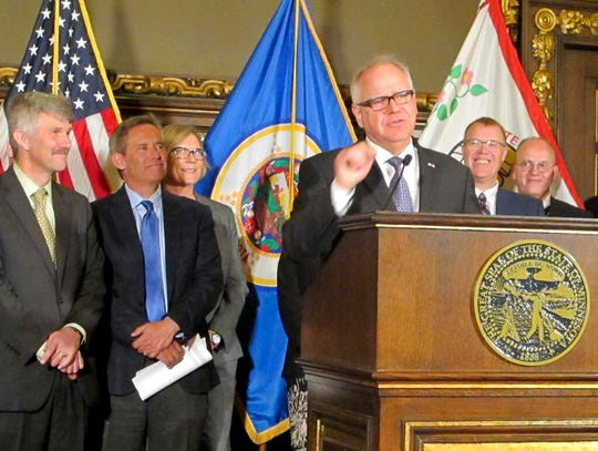 Gov. Tim Walz, center, holds a news conference with health care executives from across the state at the Capitol in St. Paul on Thursday, May 2, to stress the urgency of preserving a tax on health care providers that helps fund health care programs. Republicans want to let the tax expire as scheduled at the end of the year.