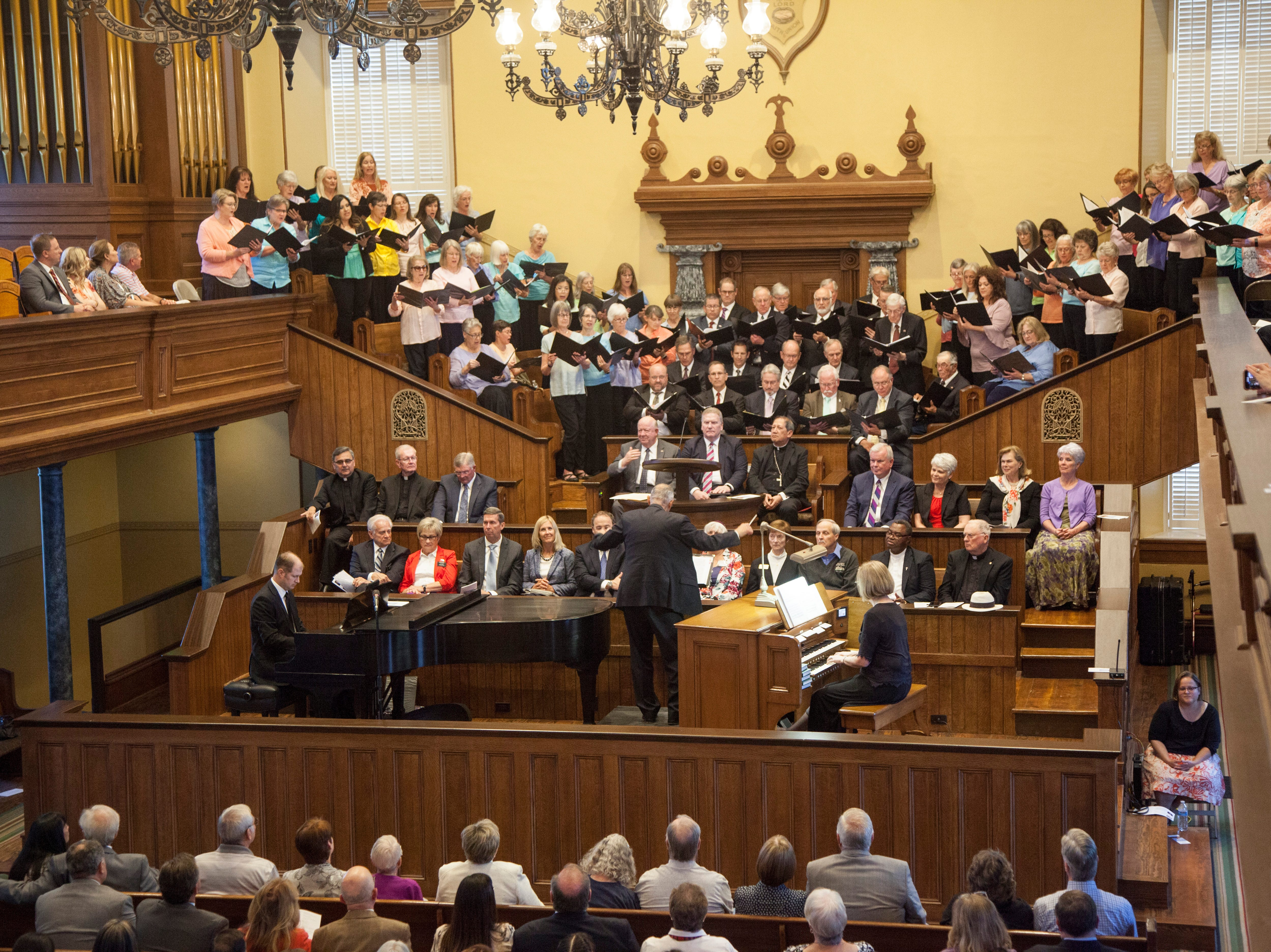 "An interfaith choir performs Beethoven's ""Hallelujah"" at the St. George Tabernacle for an interfaith tribute Thursday, May 2, 2019."