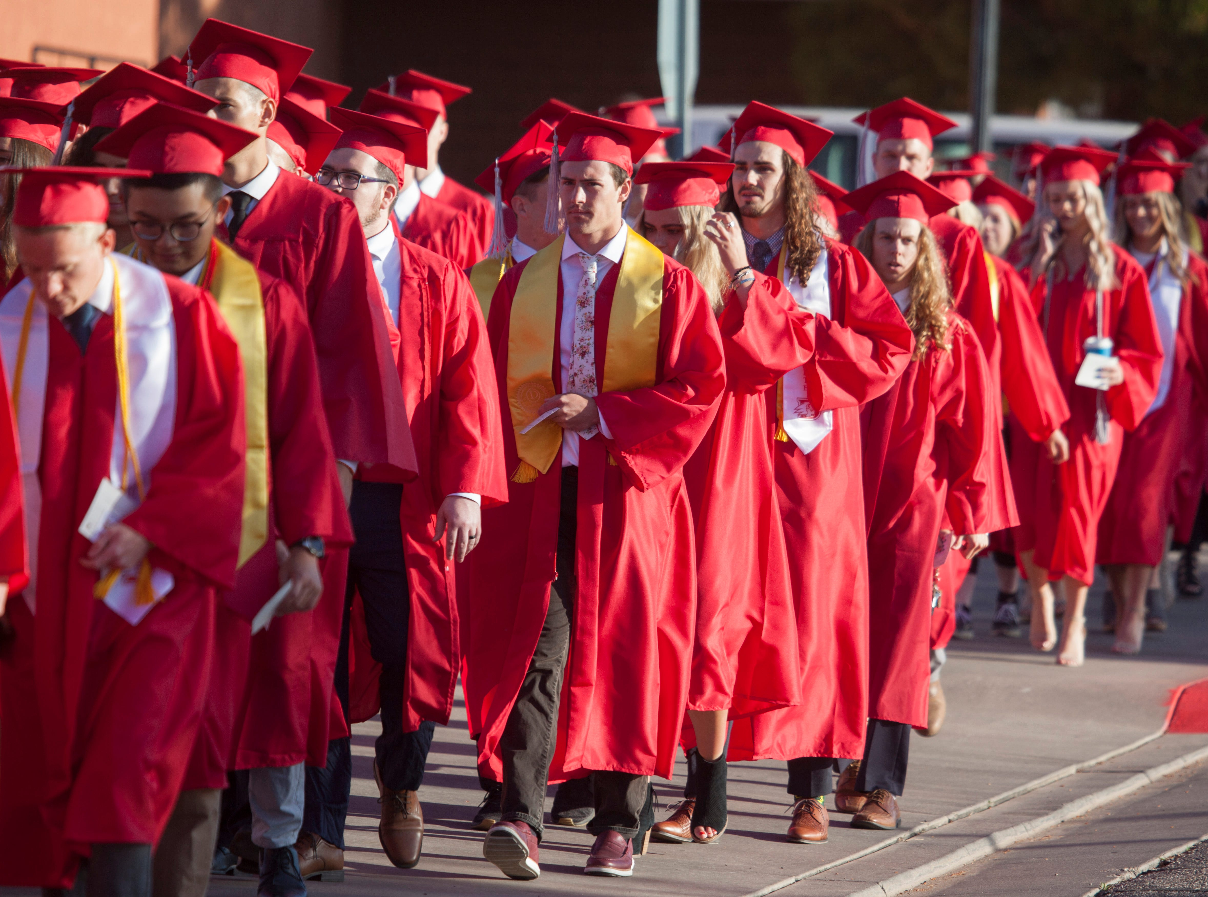 Dixie State University students and faculty commemorate the 2019 graduating class Friday, May 3, 2019.