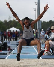 Maclay junior Robert Parker-Crawford competes in long jump during the FHSAA Track & Field State Championships at Hodges Stadium on the campus of the University of North Florida, Day 1, Friday, May 3, 2019.
