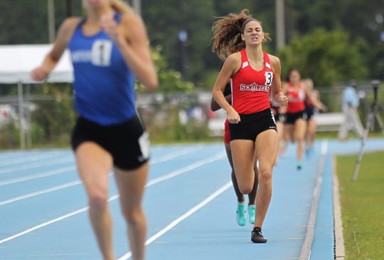 Evangelical Christian junior Sierra Oliviera races to a silver-medal finish in the 800m run during the FHSAA Track & Field State Championships at Hodges Stadium on the campus of the University of North Florida, Day 1, Friday, May 3, 2019.