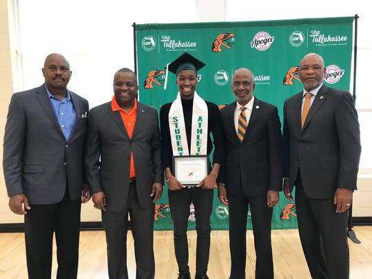 From left to right: FAMU men's basketball head coach Robert McCullum, national association president Col. Gregory Clark, Justin Ravenel, FAMU president Dr. Larry Robinson and athletics director Dr. John Eason.