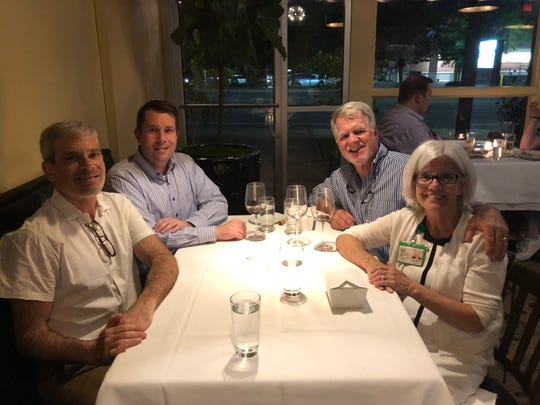 Jason Rosenthal, left forward, at dinner with Candace, Bruce, and Paul Malley,  left back.