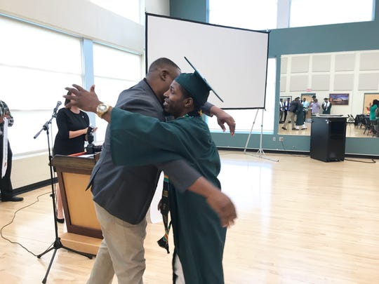 FAMU associate athletics director Vaughn Wilson (left) gives hearty embrace to LeRoy Vann during the pre commencement ceremony on May 3, 2019.