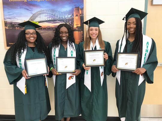 From left to right: FAMU softball players Veronica Burse, Tyra Bowers, Taylor Rosier and Edrienne Williams show off their certificates during the pre-commencement ceremony on May 3, 2019.
