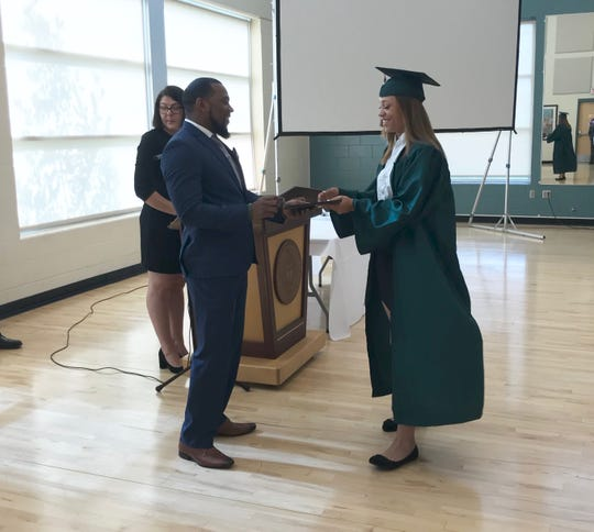 FAMU softball first baseman Taylor Rosier receives her certificate from Anthony Williams, assistant athletics director for academics during a pre-graduation ceremony on Friday, May 3, 2019.