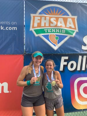 Jensen Beach's doubles team of Ellie Schoppe and Madison Dennett show off their medals after winning the Class 3A state title in Altamonte Springs on Friday.