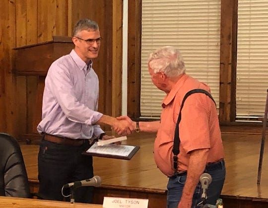Fellsmere City Manager Jason Nunemaker (left) receives the key to the city Thursday, May 2, 2019, from Mayor Joel Tyson. Nunemaker resigned in April to be the chief administrative officer for the city of Plantation in Broward County.