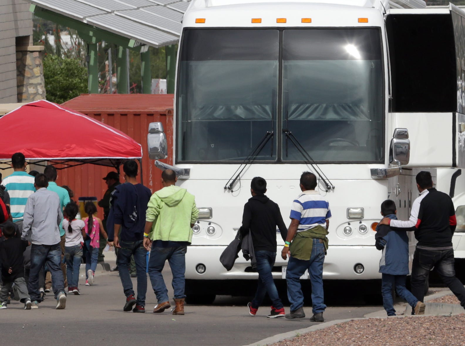 Migrants are moved about the temporary camp at the Hondo Pass Border Patrol Station in northeast El Paso before moving into the new 500-bed facility.