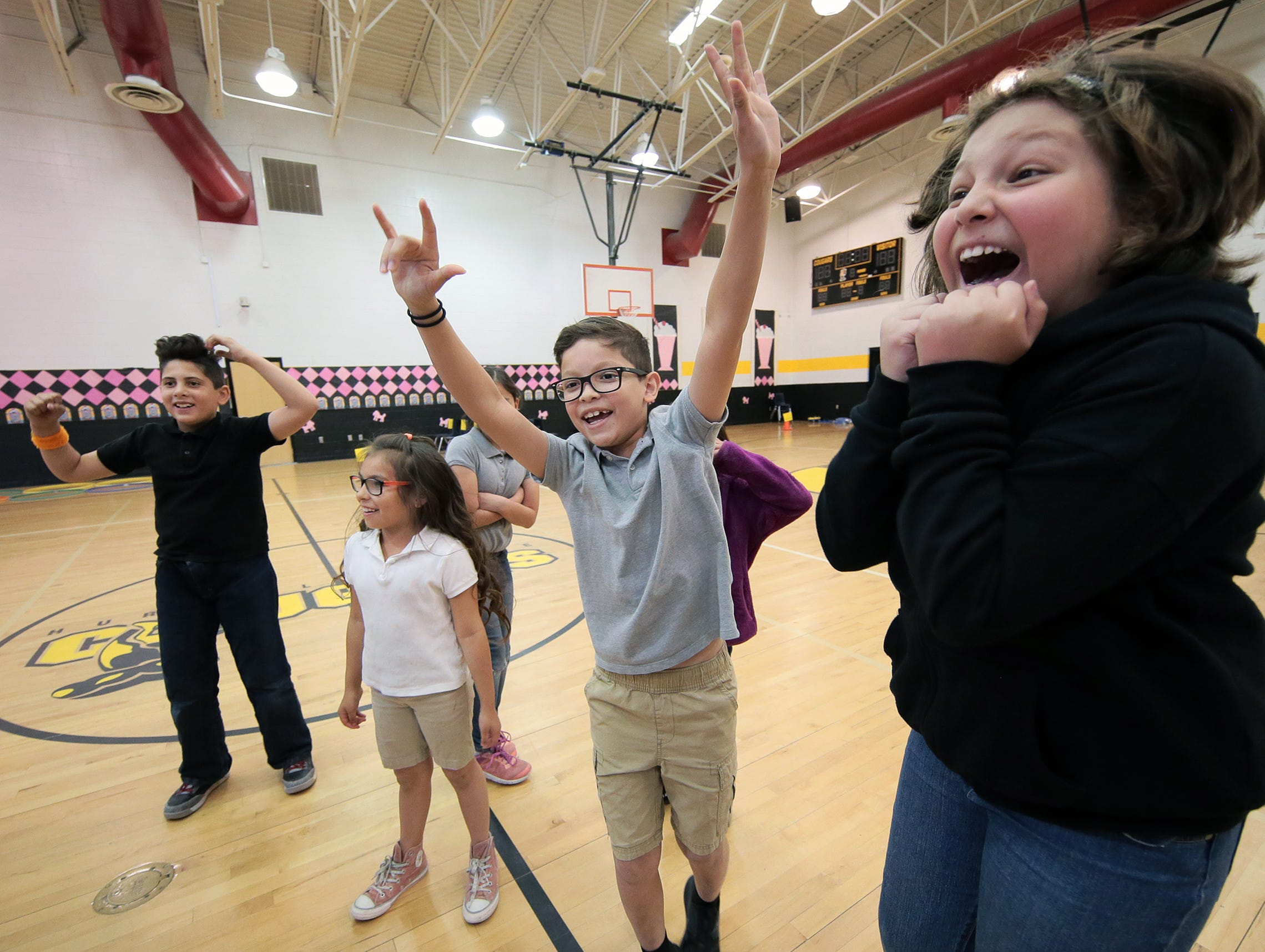 Fourth grade students celebrate after winning a math relay against fifth grade Friday during the STAAR Test rally. El Paso area schools are gearing up for the second round of STAAR testing with fun activities to relieve the stress of the standarized test.