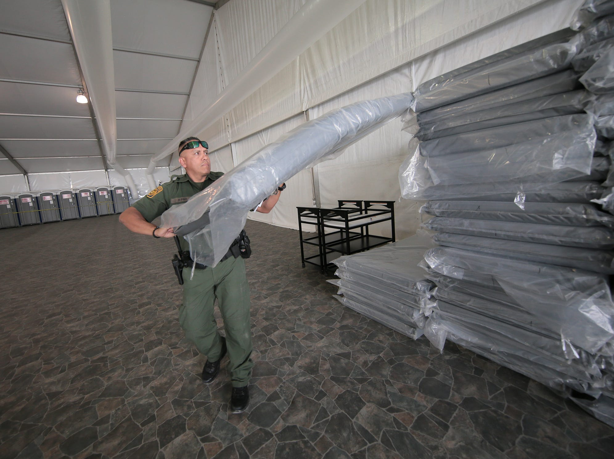 The new 500-bed migrant shelter on Border Patrol property in northeast El Paso consists of a processing area, four 125-bed pods, medical facilities and catered meals.