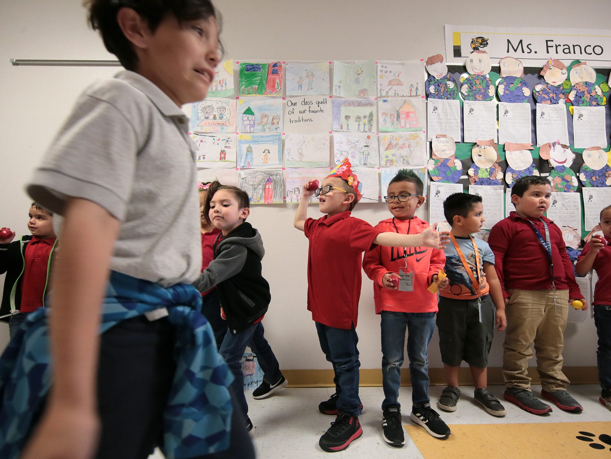 Third, fourth and fifth grade students parade through the halls of Hurshel Antwine Elementary School as they participate in a STAAR parade and rally at their school.