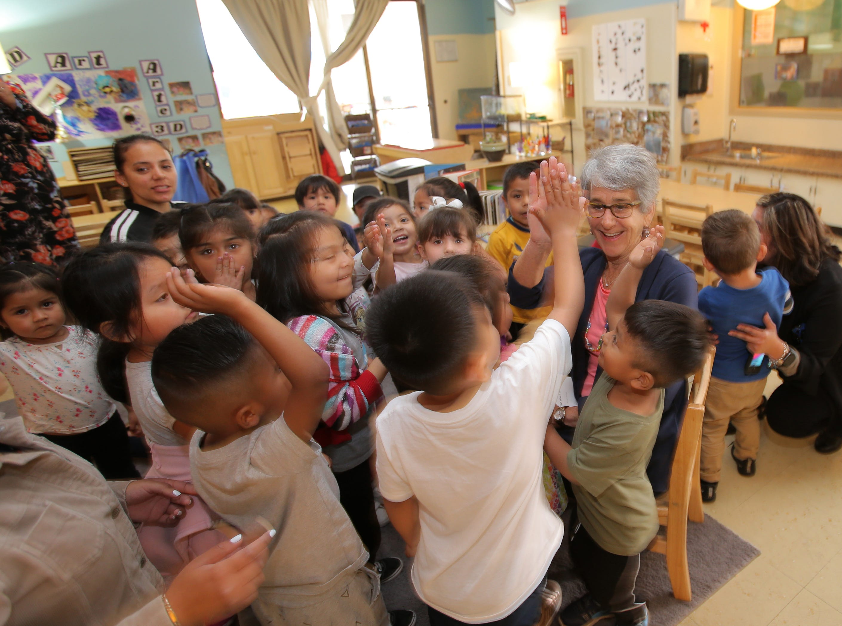 Sen. Hannah-Beth Jackson receives high-fives from preschoolers during the Take 5 and Read to Kids campaign Friday at La Escuelita Child Development Center in Oxnard.