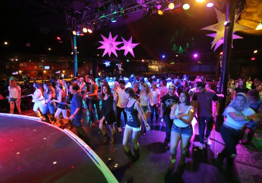 Country-western line dancers hit the floor during the Borderline Country Night, which is held every Wednesday at the Canyon nightclub in Agoura Hills.