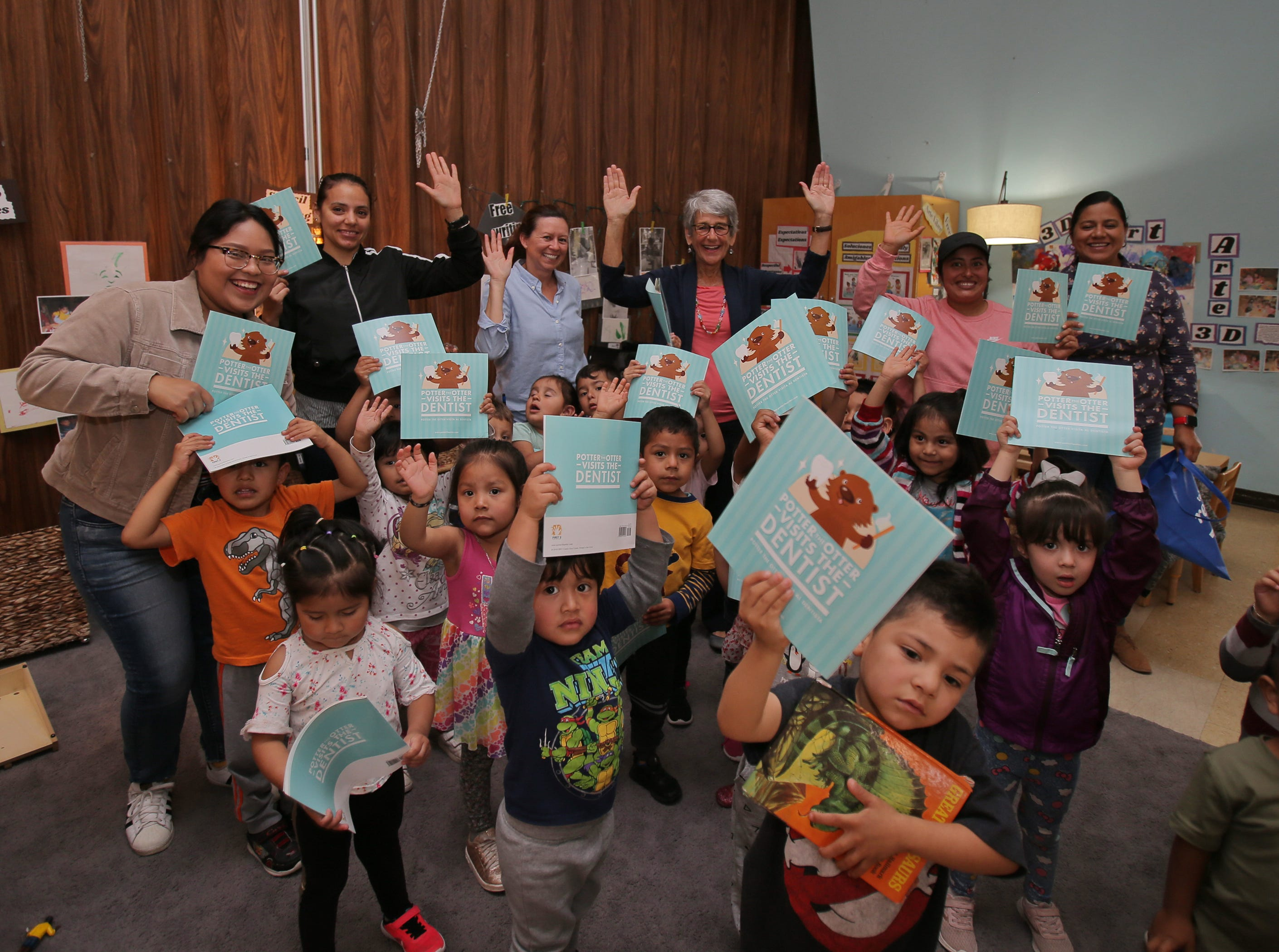 Sen. Hannah-Beth Jackson takes a photo with preschoolers after she read two books to them Friday at La Escuelita Child Development Center in Oxnard.