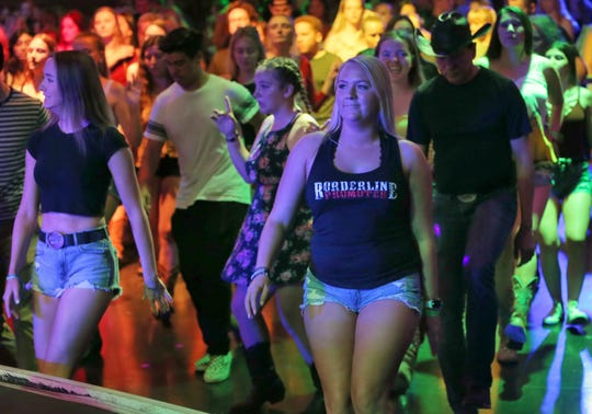 Kayla Ritchie, of Simi Valley, line dances at the Canyon nightclub in Agoura Hills during its Borderline Country Night. Ritchie survived the Nov. 7 mass shooting at the Borderline Bar & Grill in Thousand Oaks.
