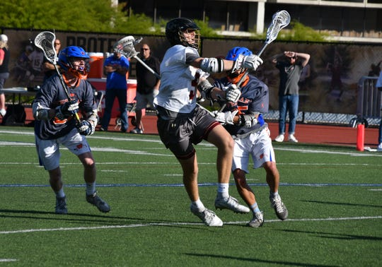 Oaks Christian senior Mike Spaeth shoots on goal against Westlake on Thursday in the U.S. Lacrosse-Southern Section Northern Division quarterfinals.