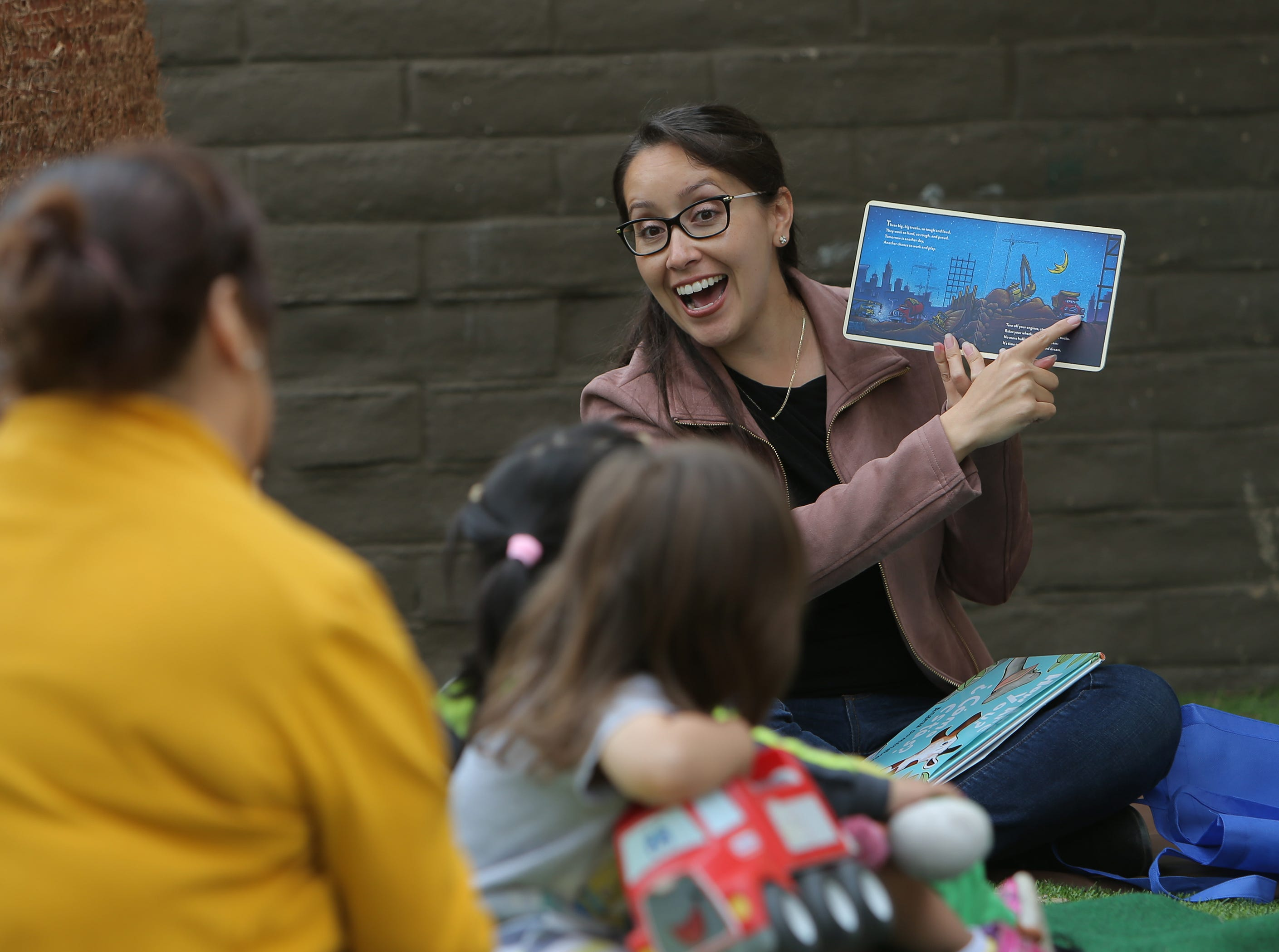 Oxnard City Council member Vianey Lopez reads to preschoolers during the Take 5 and Read to Kids campaign Friday at La Escuelita Child Development Center in Oxnard. The class that she read to was made up of 2-year-olds.