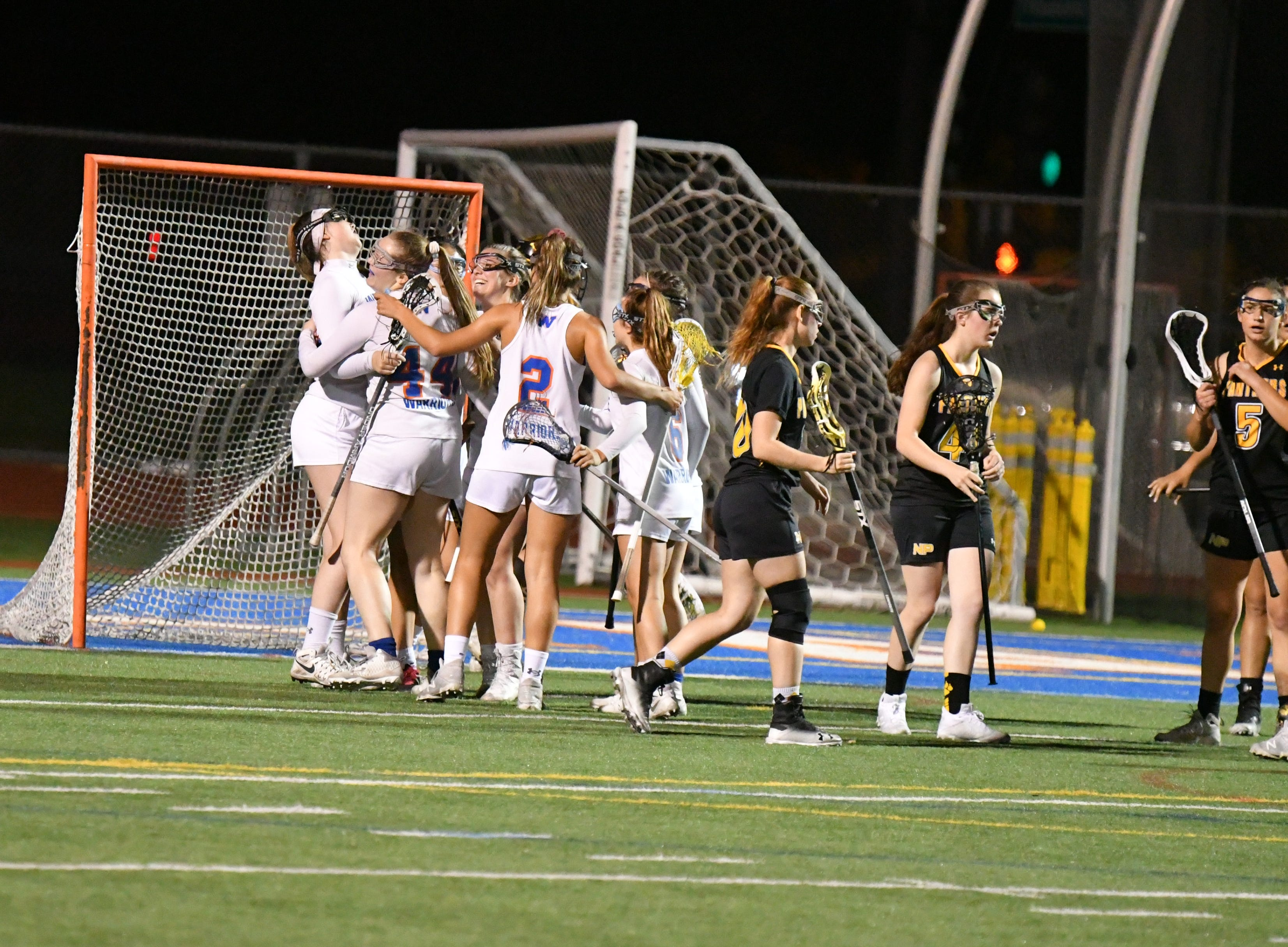 Westlake High girls lacrosse players celebrate after scoring a goal against Newbury Park on Thursday in the U.S. Lacrosse-Southern Section Northern Division quarterfinals.