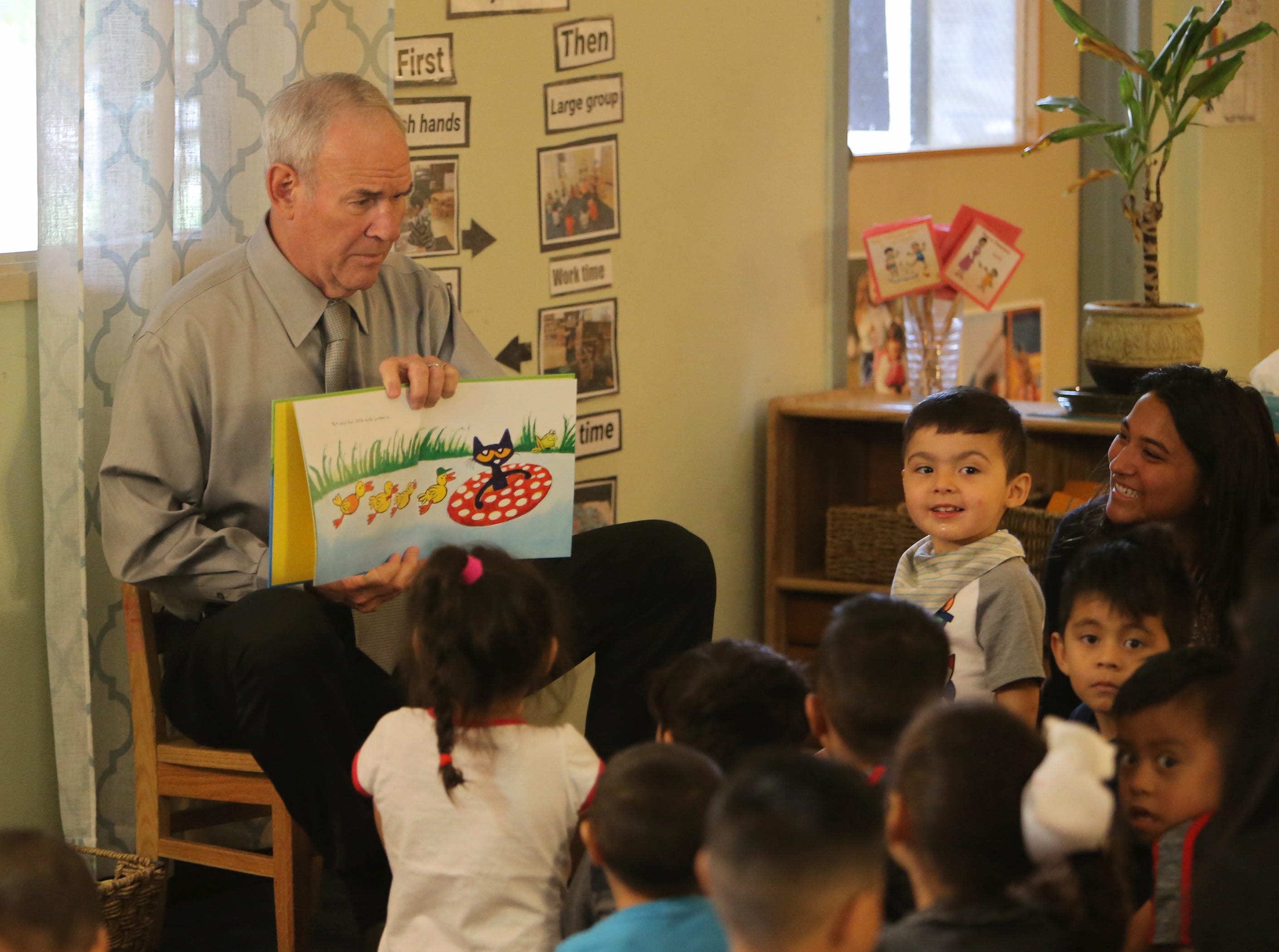 Children from La Escuelita Child Development Center listen to Ventura County Superintendent of Schools Stan Mantooth as he reads to them Friday in Oxnard during the fourth annual Take 5 and Read to Kids campaign.