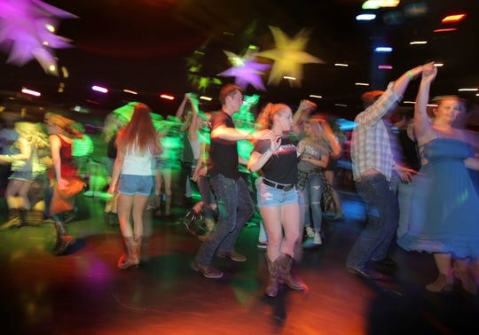 Country western dancers hit the dance floor during the Borderline Country Night held every Wednesday at the Canyon Club in Agoura Hills. Guests 18 and over  enjoy line dancing and two-stepping to the latest country music hits. The Canyon Club has become a gathering place for country-western fans displaced after the Nov. 7 shooting.