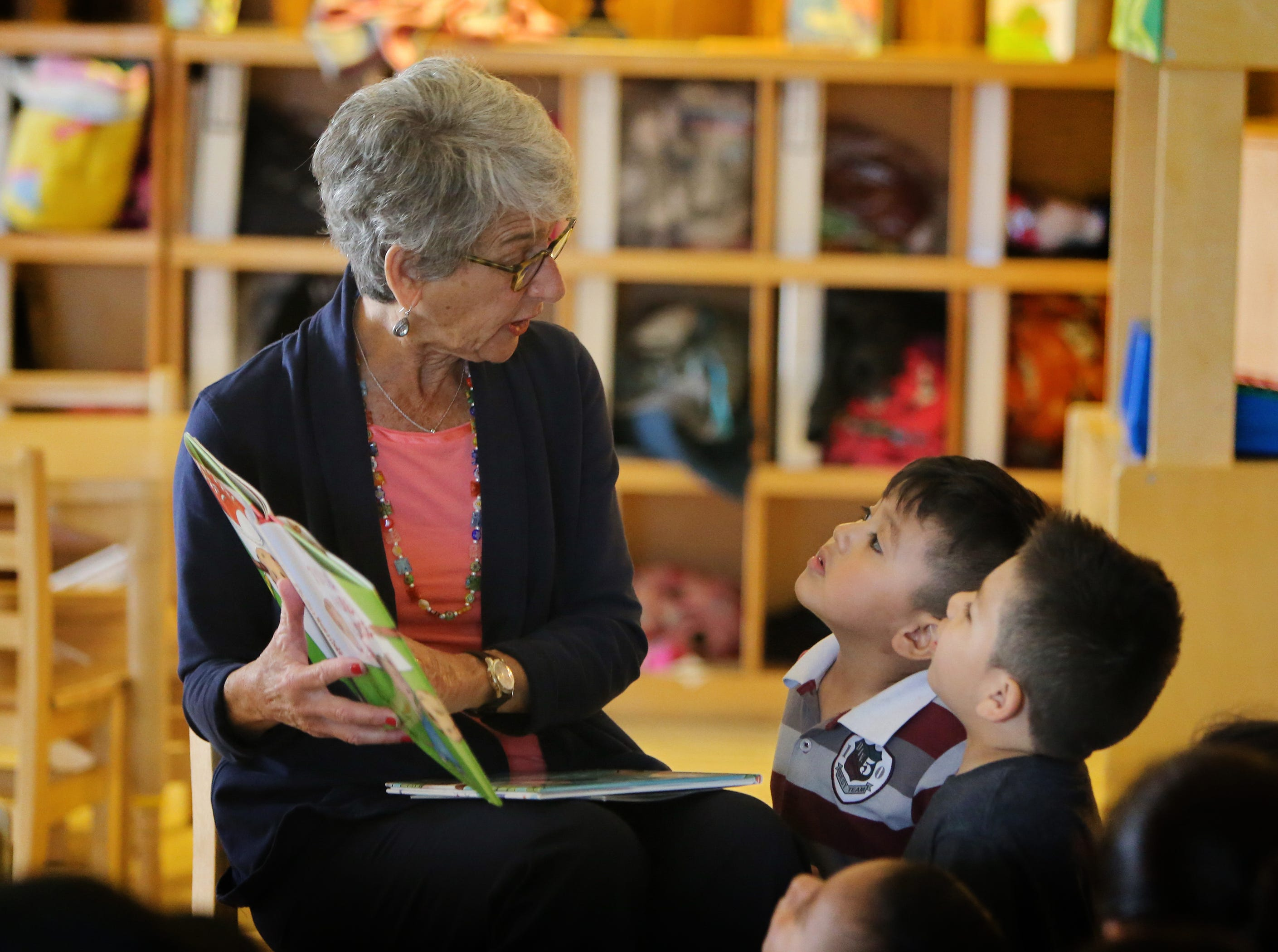Adrian Rosales, right, 4, and Atzel Montiel, 3, listen to Sen. Hannah-Beth Jackson read a book to their preschool class at La Escuelita Child Development Center in Oxnard on Friday. More than 50 local celebrities participated in Take 5 and Read to Kids, an early literacy campaign organized by First 5 Ventura County and co-sponsored by The Star.