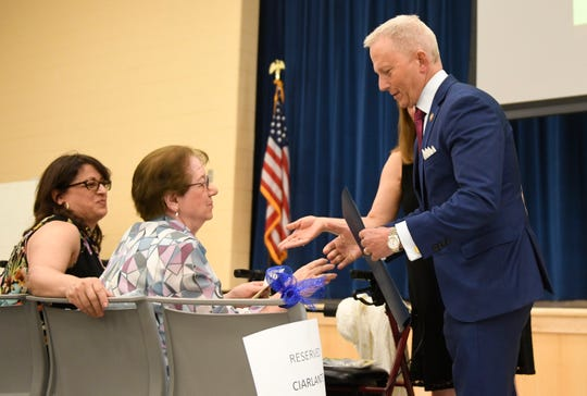 Congressman Jeff Van Drew hands Anna Ciarlante a congressional proclamation during a dedication ceremony at Sgt. Dominick Pilla Middle School on Thursday, May 2, 2019.