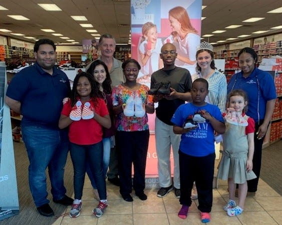 (From left) Jeromi Semidey, staff member, Boys & Girls Club of Vineland, Jamora Spellman, club member, Olivia Cruz, founder, Love Through Laces, Alex Kaganzev, club board member, Fashionette Smith, club member, Ta'Ziyah Smith, club member, Michael Spellman, club member, Miss Vineland Marissa Marchese, Gemma Santiago, club member, and Jaquay Patton, club unit director, are shown during their recent visit to Famous Footwear.