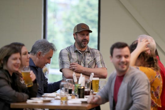 Captain Lawrence Founder Scott Vaccaro chats with guests in the recently opened beer hall.