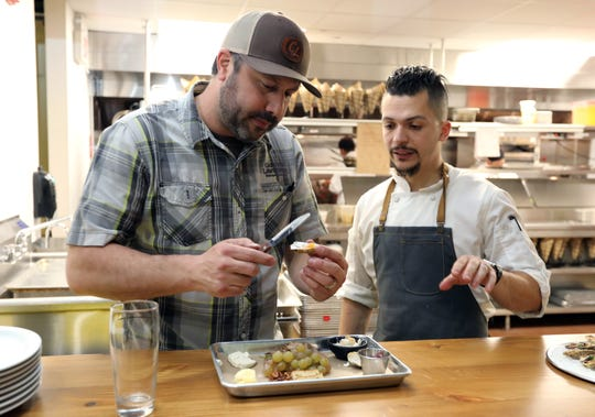 Scott Vaccaro, owner of Captain Lawrence Brewery in Elmsford with Executive Chef Tim Ocasio in the kitchen of the brewery's new beer hall May 1, 2019.