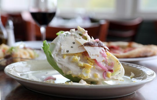 Iceberg wedge salad with creamy Caesar dressing, pickled onions, peppercorn pecorino, hard boiled egg and anchovy at the Riverview restaurant in Cold Spring May 2, 2019.