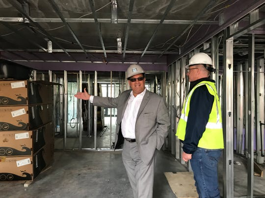 Joe Apicella, left, managing director of development with MacQuesten Development, tour the 22 S. West tower next to the Mount Vernon West train station along with Chris Yeates with the construction management team.