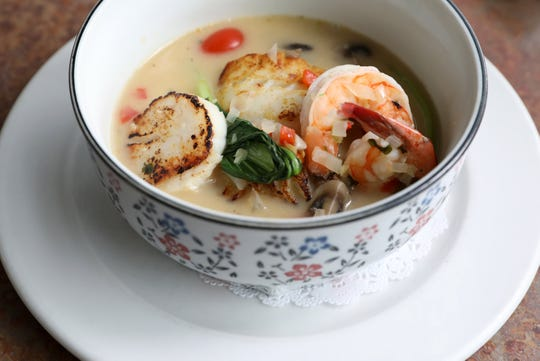 Fish and shellfish stew with baby bok choy and Thai chili in lemon grass broth at the Riverview restaurant in Cold Spring May 2, 2019.
