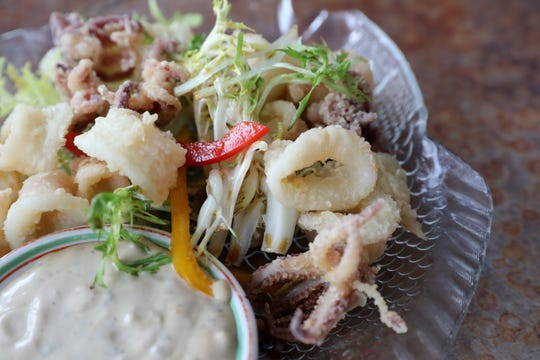 Crispy calamari and frisŽe salad with Chinese mayo at the Riverview restaurant in Cold Spring May 2, 2019.