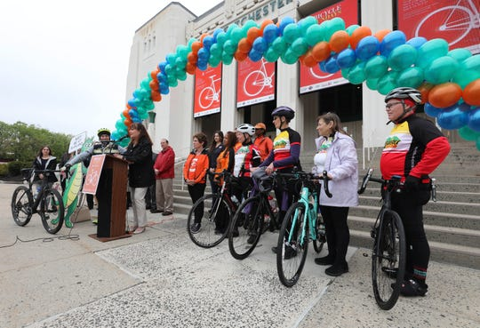 Westchester County Parks Commissioner Kathleen O'Connor speaks at the podium, as members of the Yonkers Bike Club, the Westchester Cycle Club and other officials look on as they attend a kick-off for the 45th annual Bicycle Sundays in front of the Westchester Country Center, May. 3, 2019. The program runs from 10:00 a.m. to 2:00 p.m. Sundays in May, June and September (except holiday weekends), where the Bronx River Parkway closes to cars between the Westchester County Center in White Plains and Scarsdale Road in Yonkers, a round trip of just over 13 miles.
