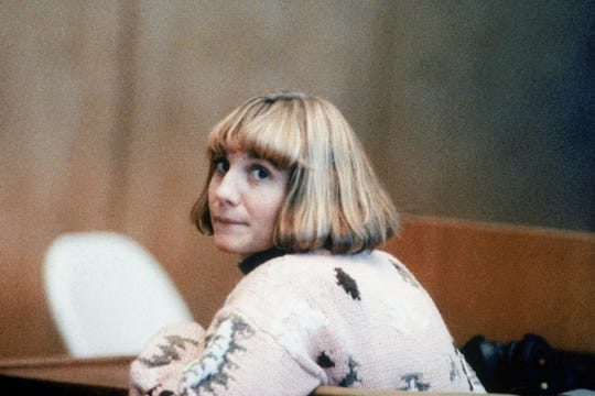 Ex-school teacher Carolyn Warmus looks over her shoulder in Westchester County Court, Jan. 22, 1991. Warmus is on trial for the murder of Betty Jeanne Solomon, her lover's wife.
