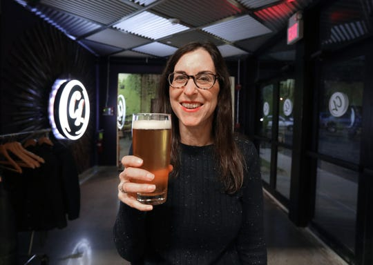 """Jeanne Muchnick at the entrance to Captain Lawrence Brewery's new beer hall at """"Dinner with Jeanne"""" on May 1, 2019."""