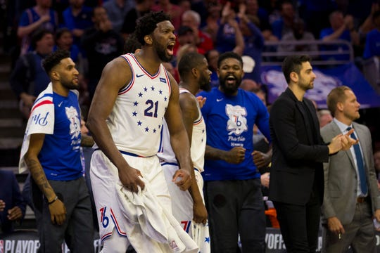 Joel Embiid #21 of the 76ers reacts from the bench against the Raptors in the second quarter of Game Three Thursday in Philadelphia.