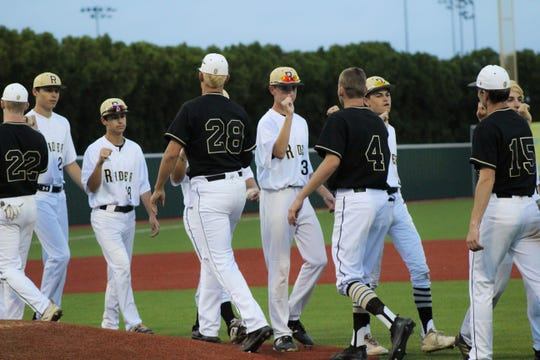 The Raiders line up to congratulate Amarillo High players after Rider's 6-0 playoff loss Thursday, May 2, 2019.