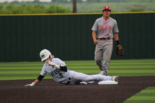Kase Johnson slides as he steals second base for Iowa Park on Thursday, May 2nd 2019 as the Hawks face the Sweetwater Mustangs. Johnson scored 3 runs in Iowa Park's 11-0 victory.