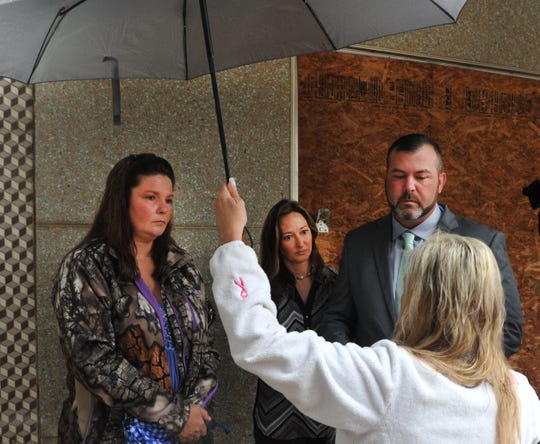 Cindy Heathcoat left, stands with Wendy and David Mills, Friday morning during the Texas Department of Public Safety's annual Click It or Ticket safety belt awareness campaign kick-off. Both families lost loved ones in vehicle accidents where wearing safety belts could have saved lives. The TxDOT event was canceled due to weather.
