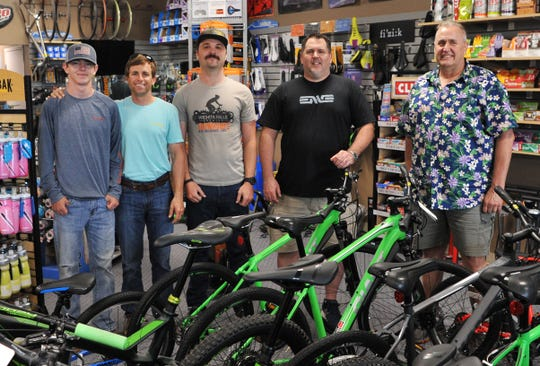 From left: Reid Hutchins, Aaron McDaniel, Luke Plumlee, Jayson Cunningham, and Larry Hein of The Bike Stop are pictured after winning the gold-level recognition as a bike-friendly business.