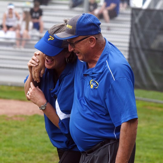 Maysville coach Greg Vaughn horses around with his niece, Philo coach Michelle Moyer, prior to their 2019 game in Duncan Falls.