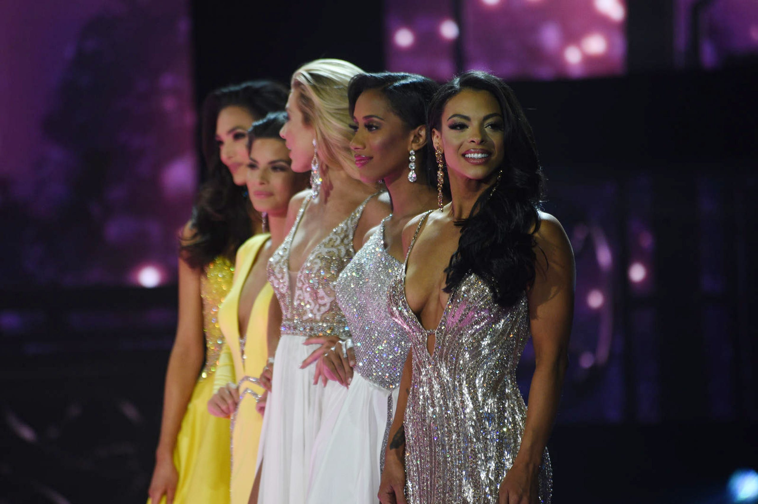 Miss Oklahoma Triana Browne, right, along with other contestants compete during Miss USA 2019.