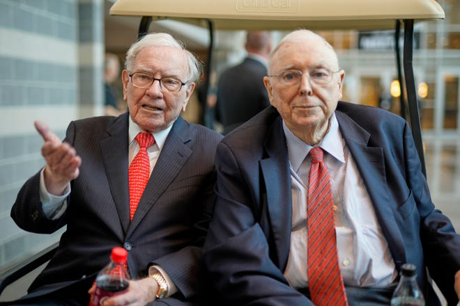 """Berkshire Hathaway Chairman and CEO Warren Buffett, left, and Vice Chairman Charlie Munger, briefly chat with reporters Friday, May 3, 2019, one day before Berkshire Hathaway's annual shareholders meeting. Buffett is typically the """"star"""" of these meetings, but Munger is never short on quotable comments."""