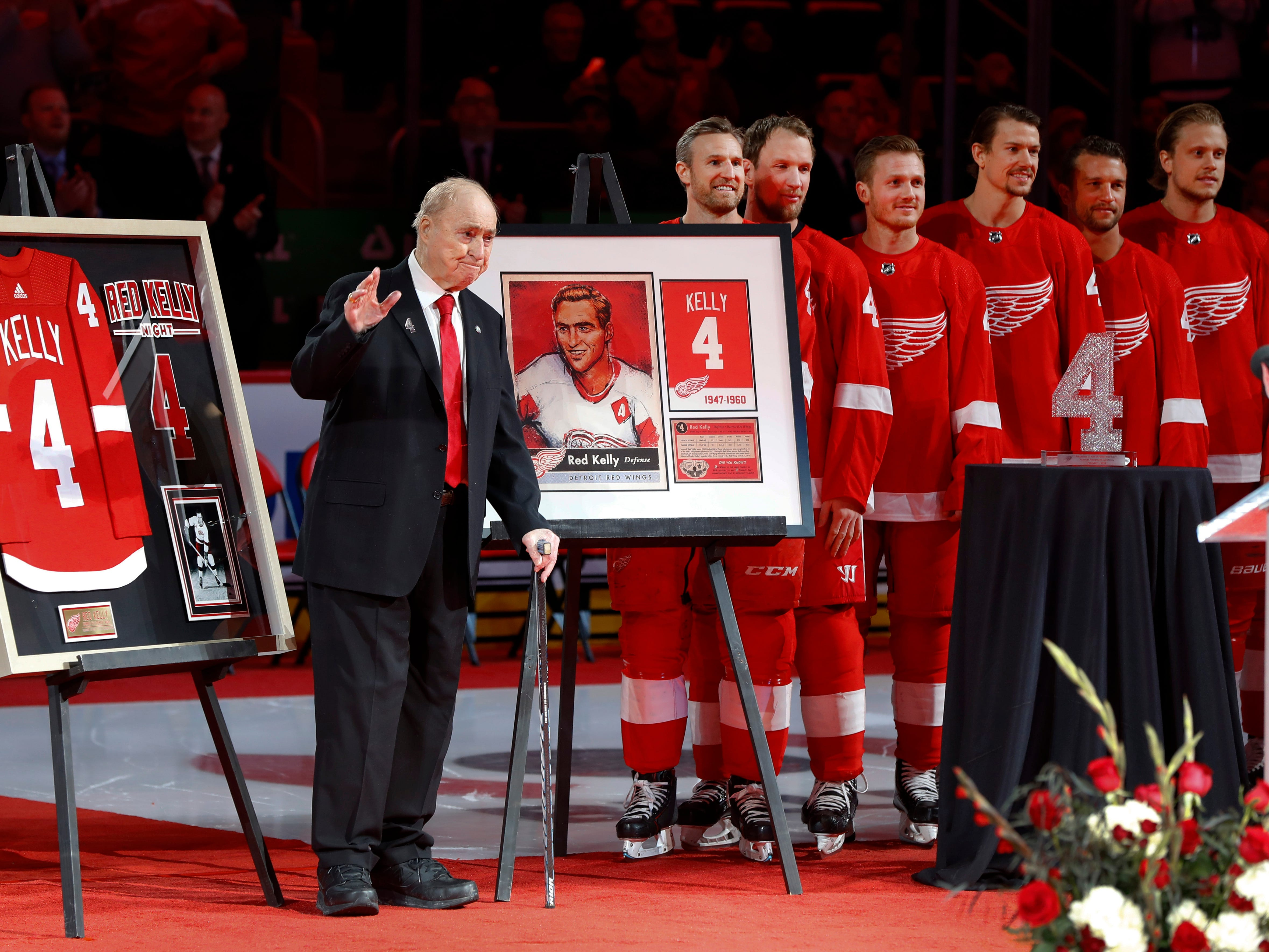 In this Feb. 1, 2019, file photo, former Detroit Red Wings player Red Kelly waves during his jersey retirement ceremony before an NHL hockey game against the Toronto Maple Leafs in Detroit. Kelly, a defenseman-turned-center whose Hall of Fame career included eight Stanley Cups while playing for Detroit and Toronto, has died, Thursday, May 1, 2019, in Toronto, He was 91.