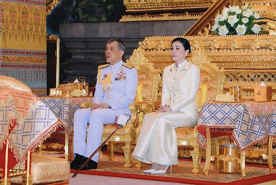 This handout from the Thai Royal Household Bureau taken on May 2, 2019 shows Thailand's King Maha Vajiralongkorn and Queen Suthida paying their respects at the Bangkok City Pollar Shrine in Bangkok.